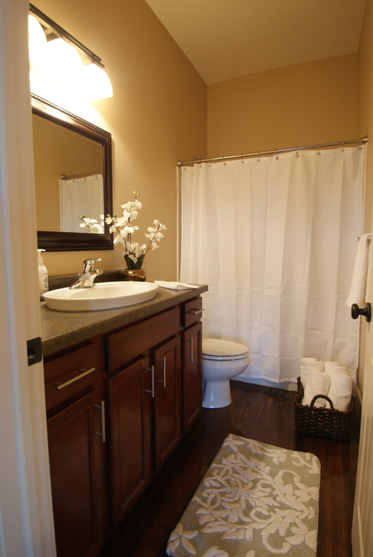 warm contemporary restroom finishes, hardware, lighting, fixtures and hardwood floors.jpg
