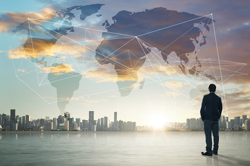 graphicstock-international-business-concept-with-businessman-on-city-skyline-background-with-network-on-map-and-sunlight_rOFam3Dxjl.jpg