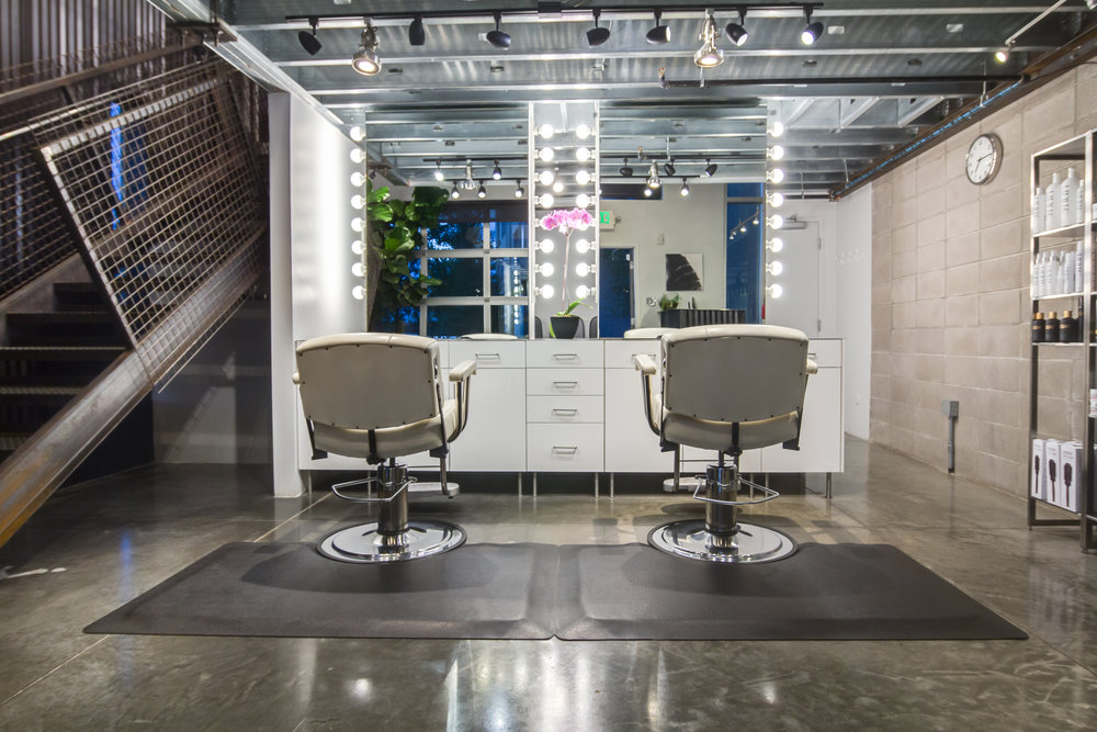 Our four-chair salon is expertly designed by Norwegian industrial design firm for comfort and precision coloring and cutting.