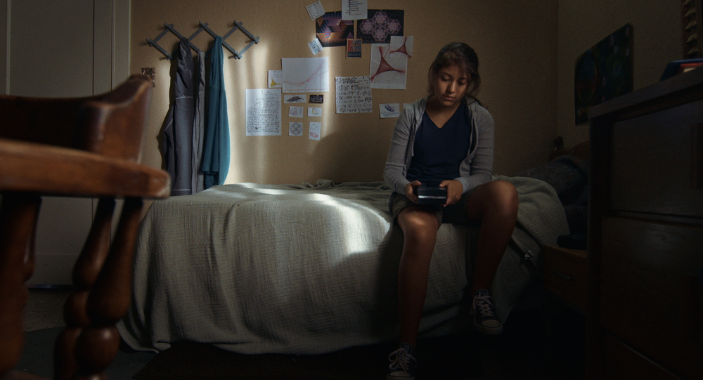 Cents - Sammy with phone in bedroom.jpg