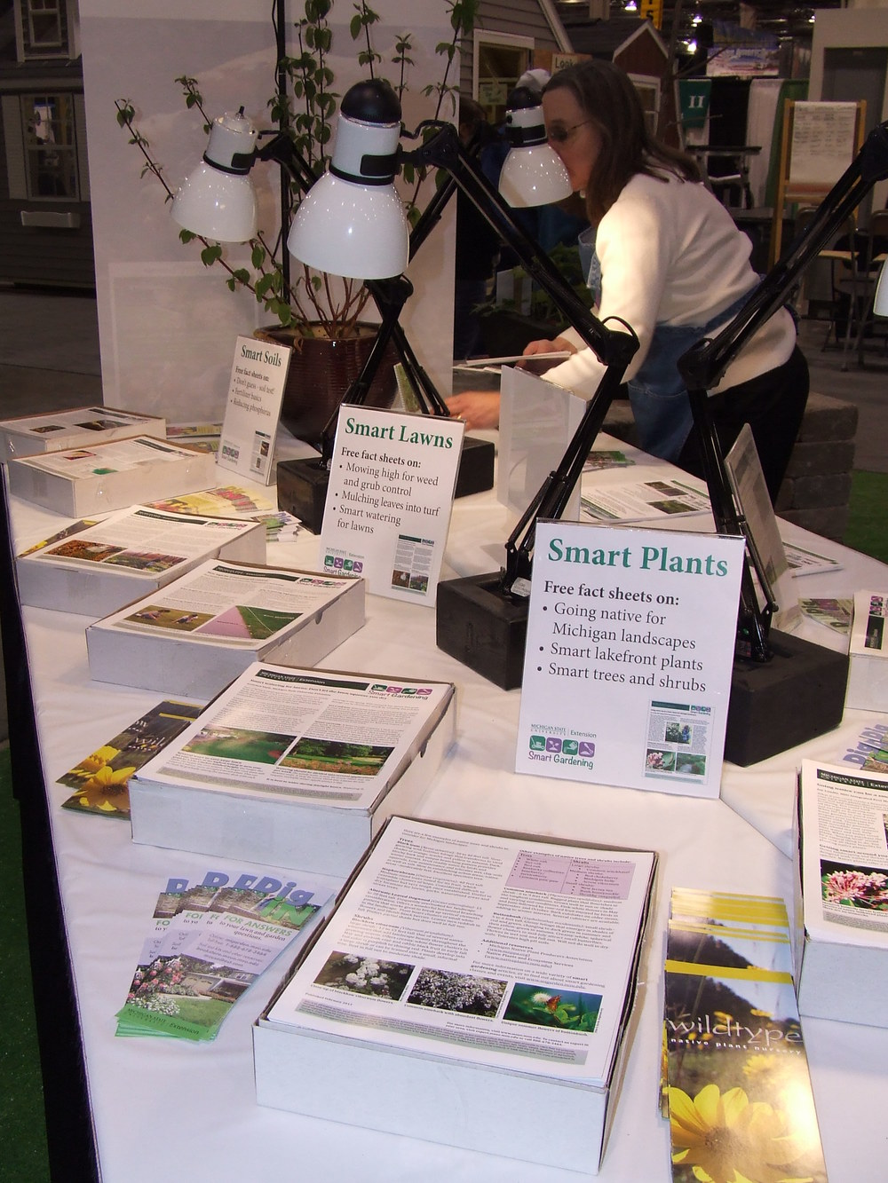 Mary Wilson hosting a Master Gardener Smart Gardening booth in Novi, Michigan.
