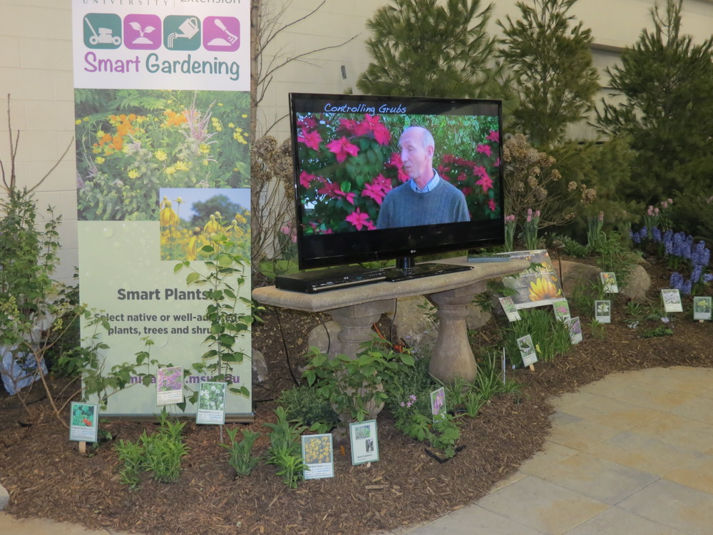 """Controlling Grubs"" video playing at the Smart Gardening booth at the Home and Garden Show in Grand Rapids."