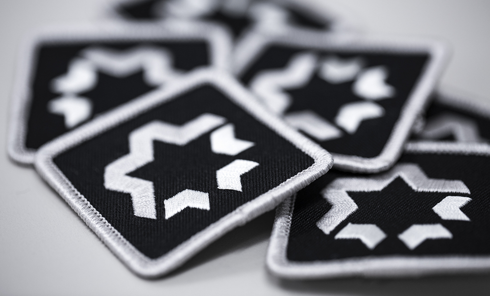 EMBROIDERED PATCH W/ MERROWED EDGE