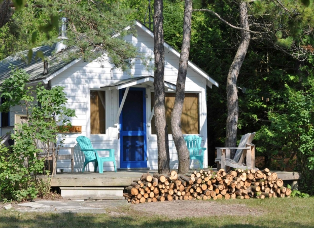 Enjoy a rustic cabin in the woods across the path from miles of SUP opportunities
