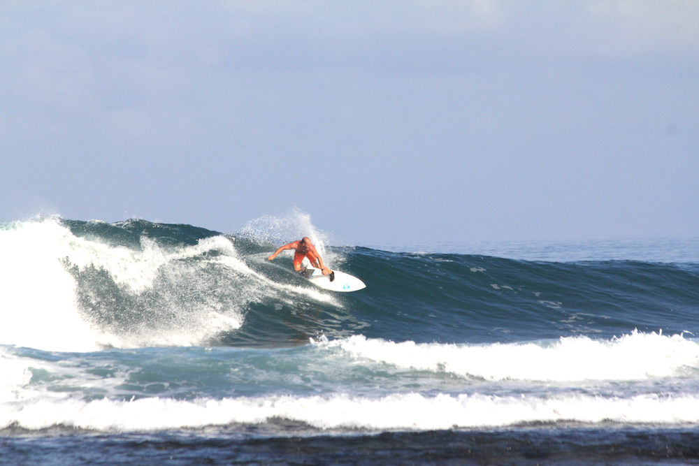 Alex Brost gets back on board somewhere sunny where the waves are good like Indonesia.  Photo by Alex Linnell.