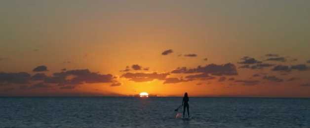 Stand up Paddling into the sunset during Super Bowl XLV's Carnival Corporation commercial.  What would JFK say today about the fastest growing watersport in the world and growing?