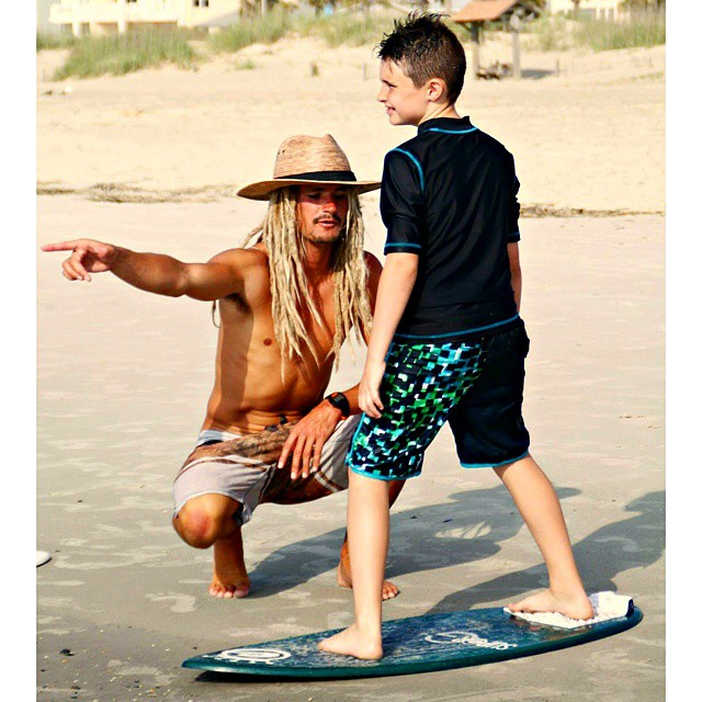 Austin teaching groms at his skim school in Tybee Island Georgia.  He was born nearby in Savannah.