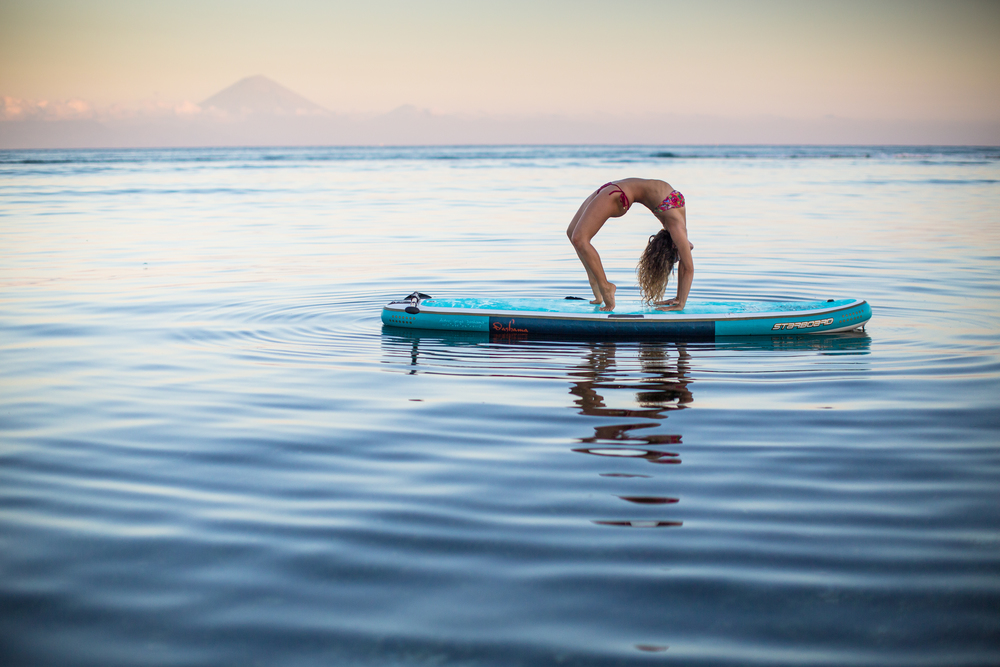 "Dashama featured in the ""World of SUP Yoga"" issue.  Photos by Mick Curley"
