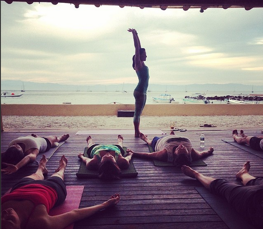 Morning beach yoga to emphasize and drop in the present moment