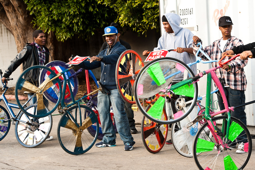 A scraper bike is an ordinary bicycle that has been modified by its owner, typically with decorated spokes with candy-colored pinwheels and matching body and wheel colors, using tinfoil, re-used cardboard, candy wrappers and paint. — Wikipedia