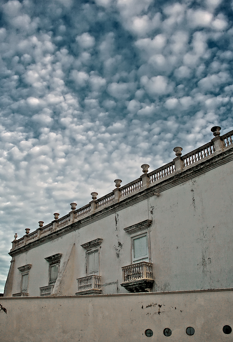 balconies and cotton sky