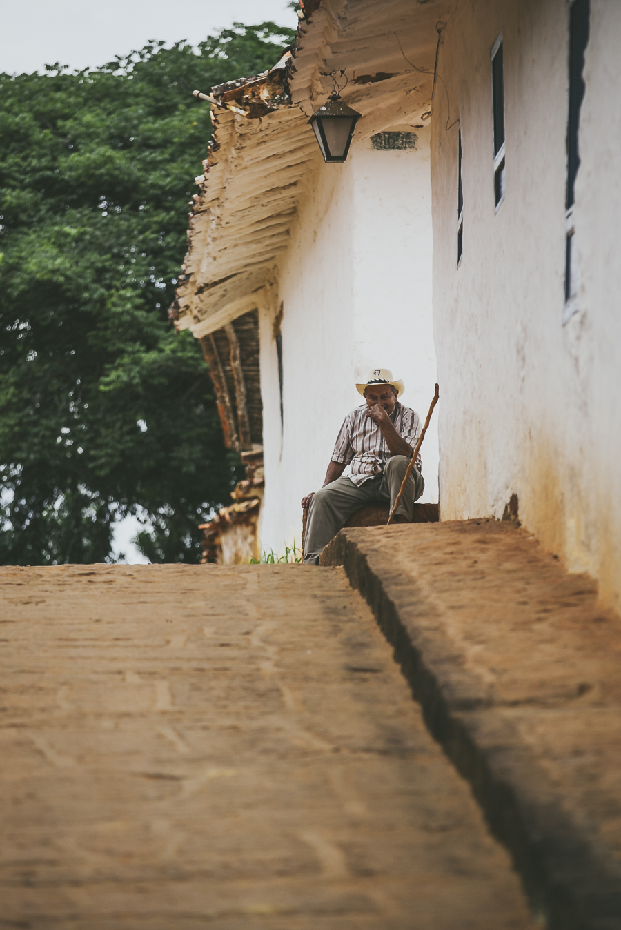 Man on sidewalk, Barichara streets. Colombia.