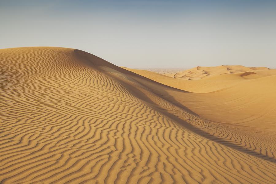 Desert dunes in Al-Hebab Desert, Dubai, UAE.