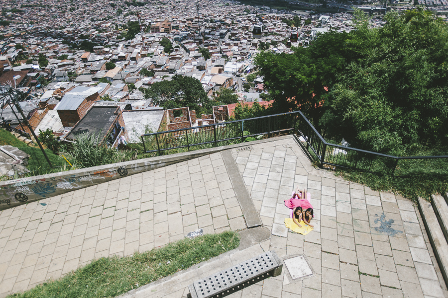 Two girls sunbathing in las comunas of Barrio Santo Domingo, Medellin. This was shot near the Biblioteca España (library).