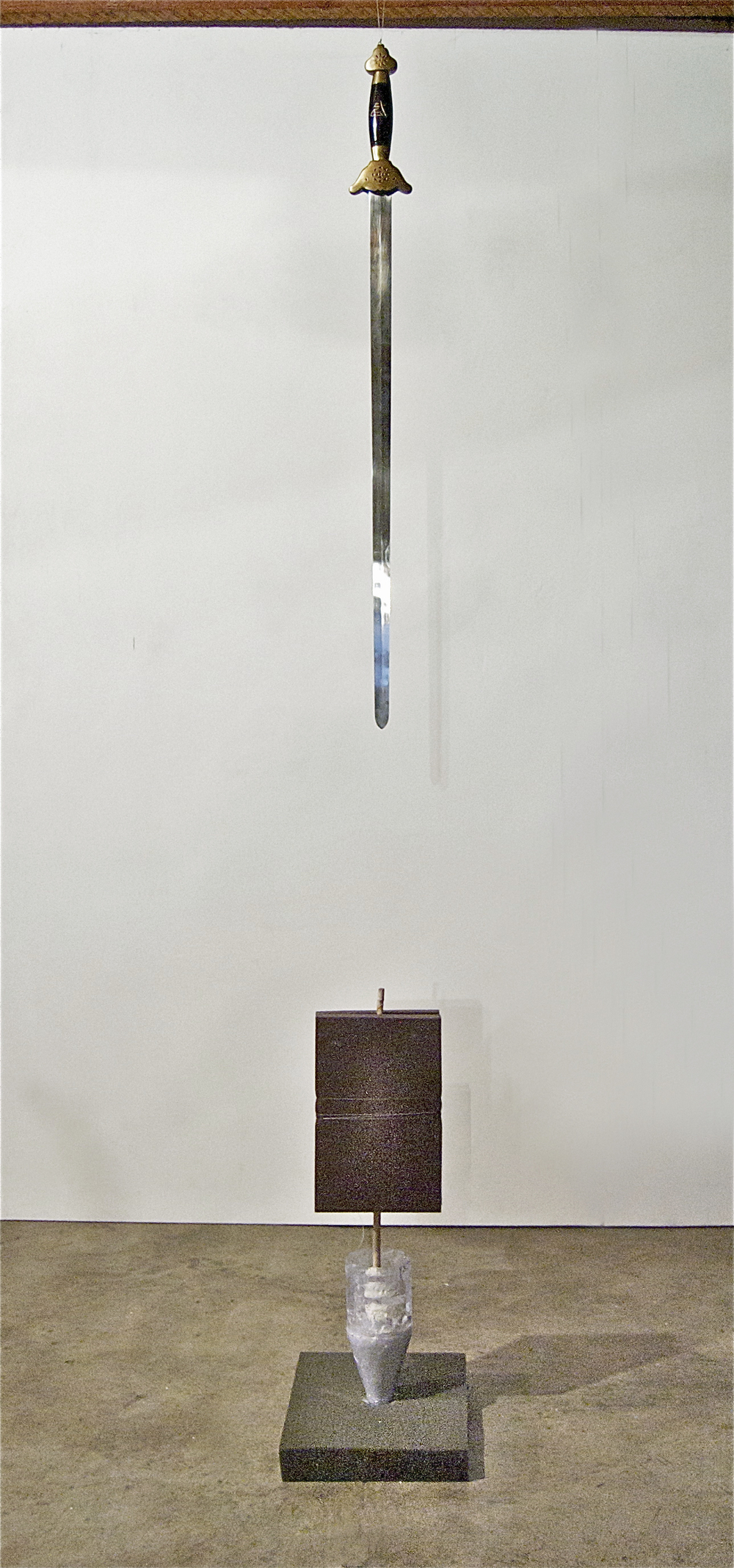 "Untitled (taiji), 2011.  78"" X 10"" 13""  tai chi straight sword, foam, fishing line, bamboo, plastic bottle, plaster, lint."