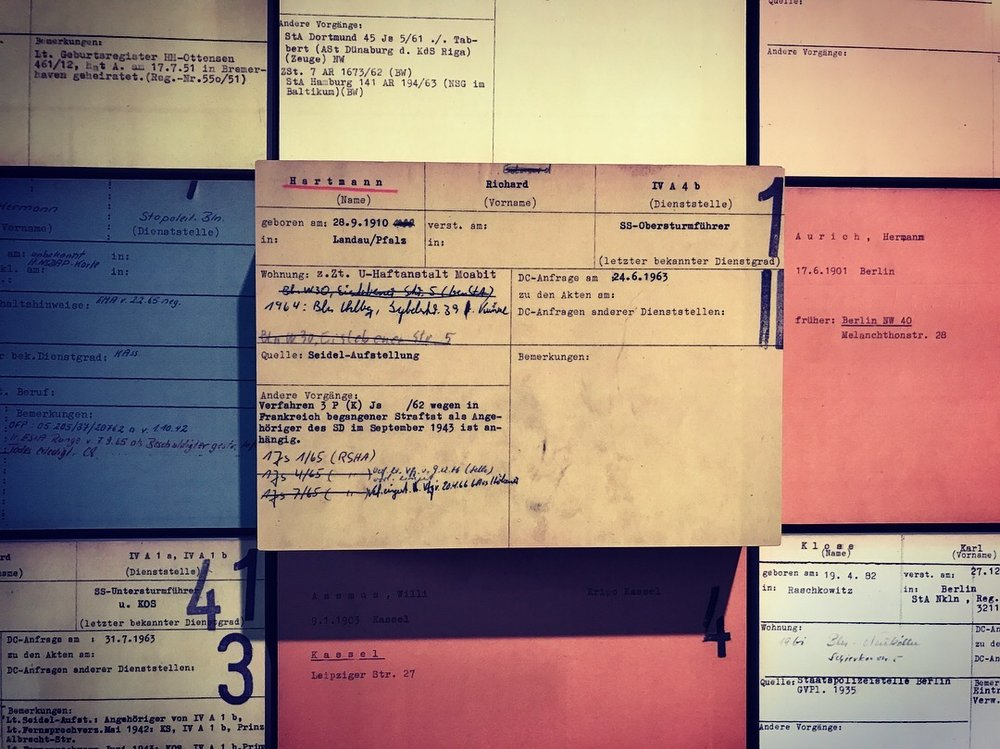Index cards detailing the identities of SS members of the Third Reich targeted for prosecution in the postwar judicial proceedings of the new Federal Republic. Raised cards like this are one of only 16 out of 7000 that were ever fully prosecuted. © Matt Schultz