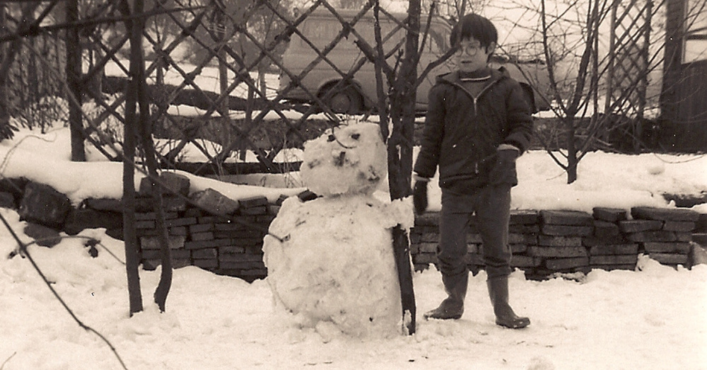 Jane and the snowman. In the back yard of her families Endon Village home around 1970