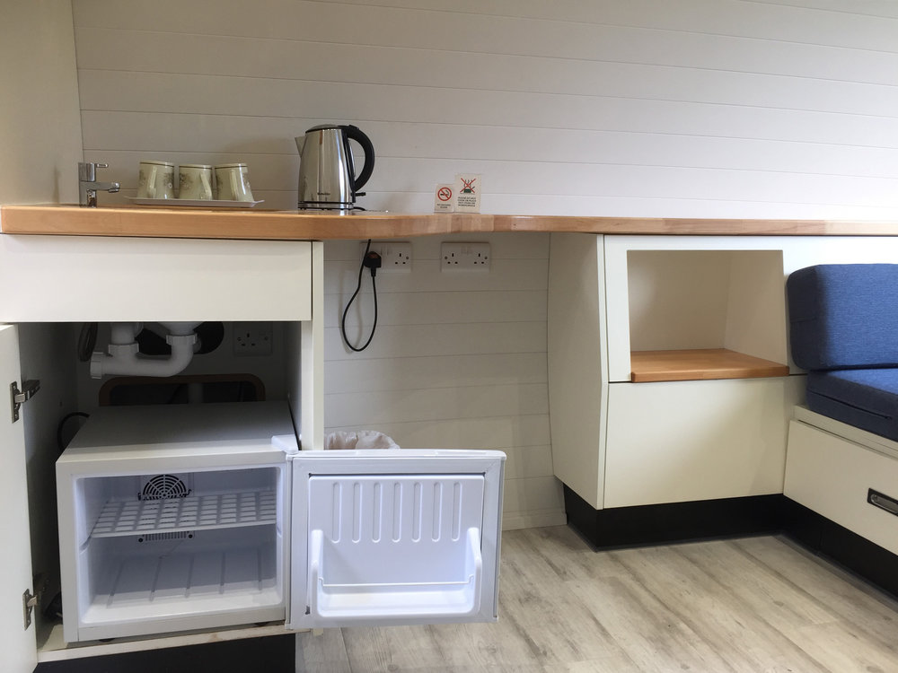 3 berth Pod includes fridge and kettle and plug sockets.