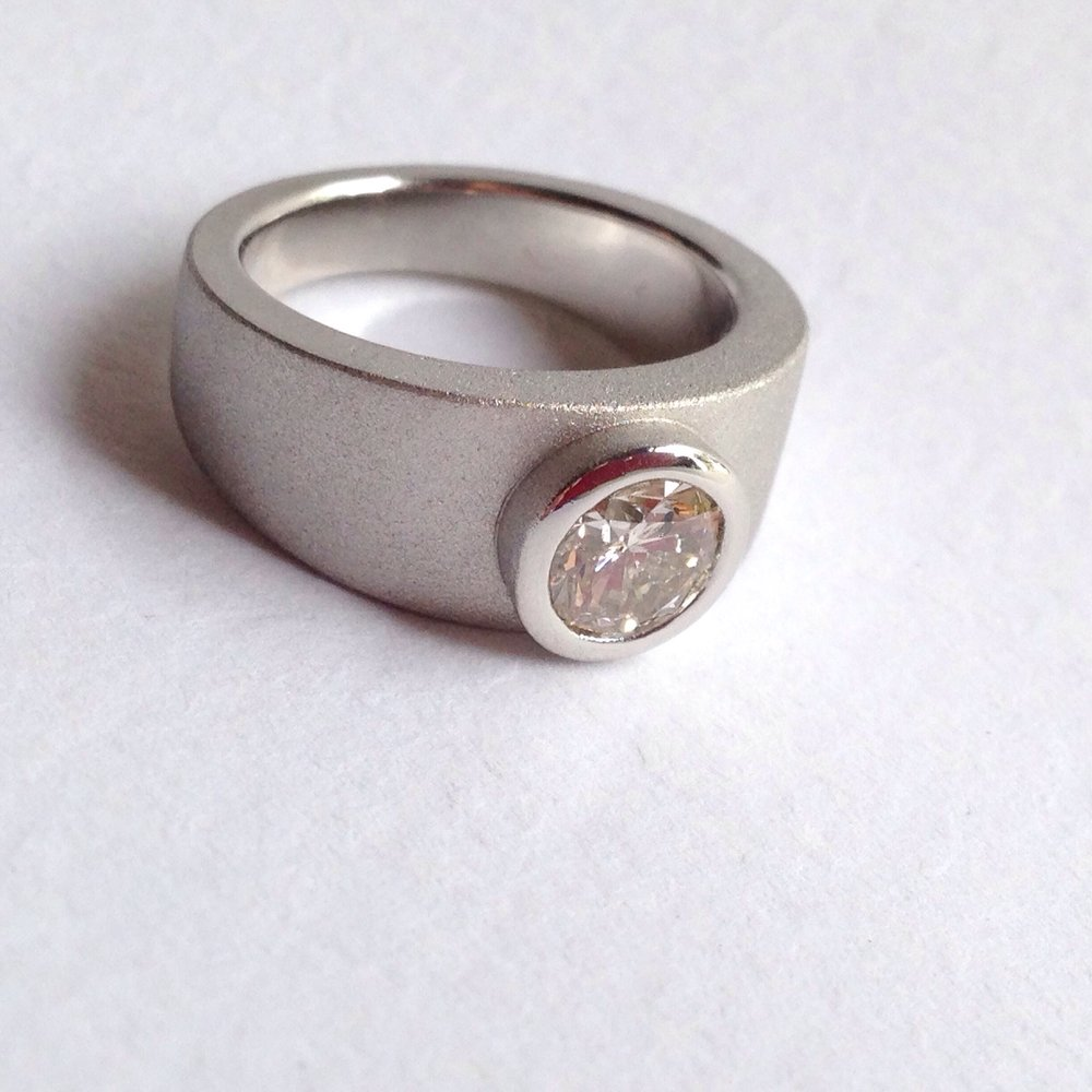 A custom design for a customer who came to me with an inherited stone from her mother. I cast this ring in platinum and gave it a bead blast finish.