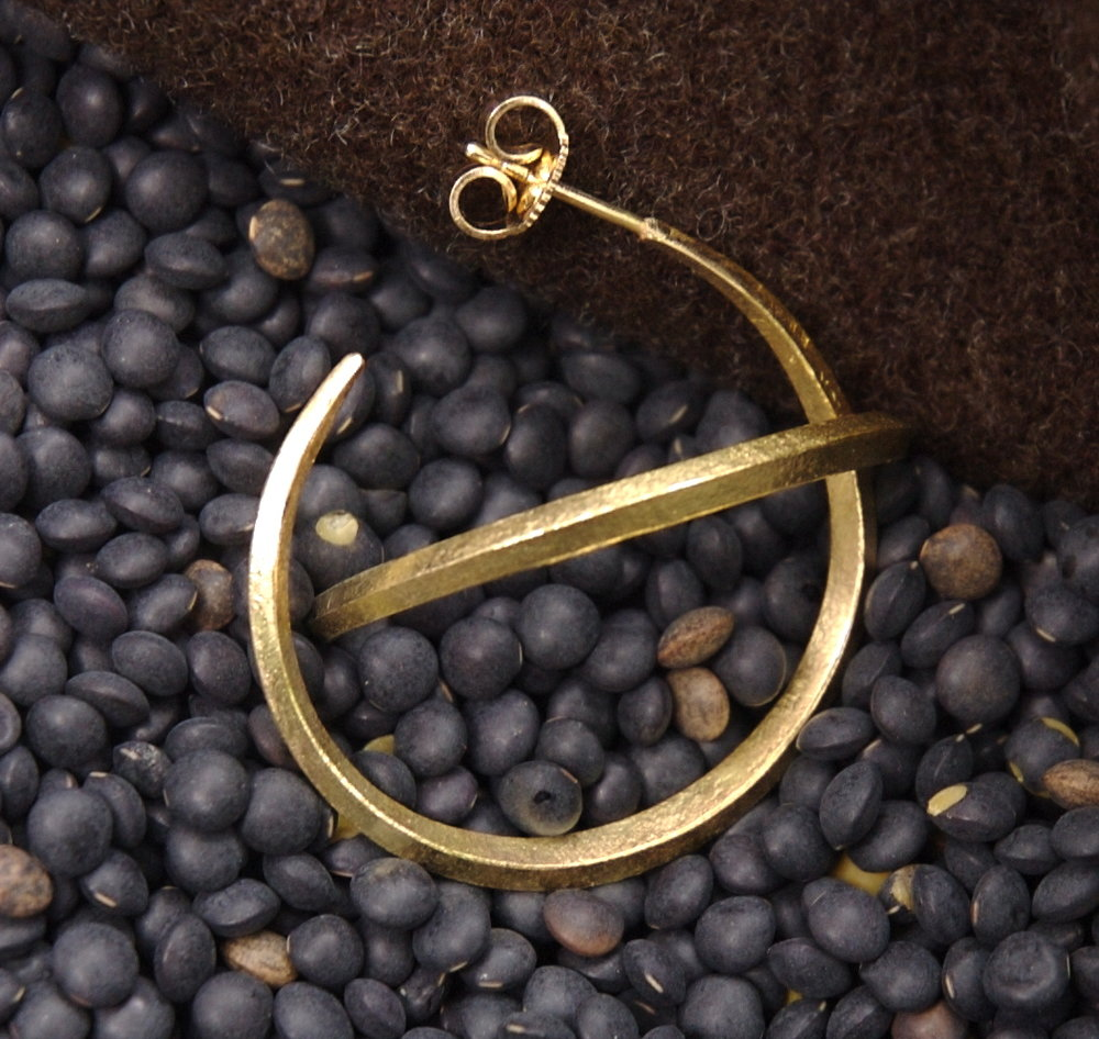 These very delicate 18k hoops were forged with a hammer on an anvil.