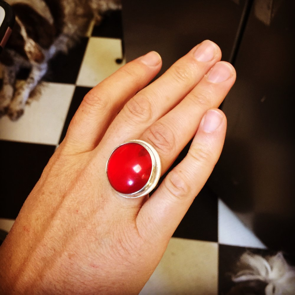 "From diamonds and 24k gold, to this ring I made for my daughter recently out of an old plastic reflector that I knew would make a wonderful ""ruby"" ring someday... complete with a heart shape cutout."