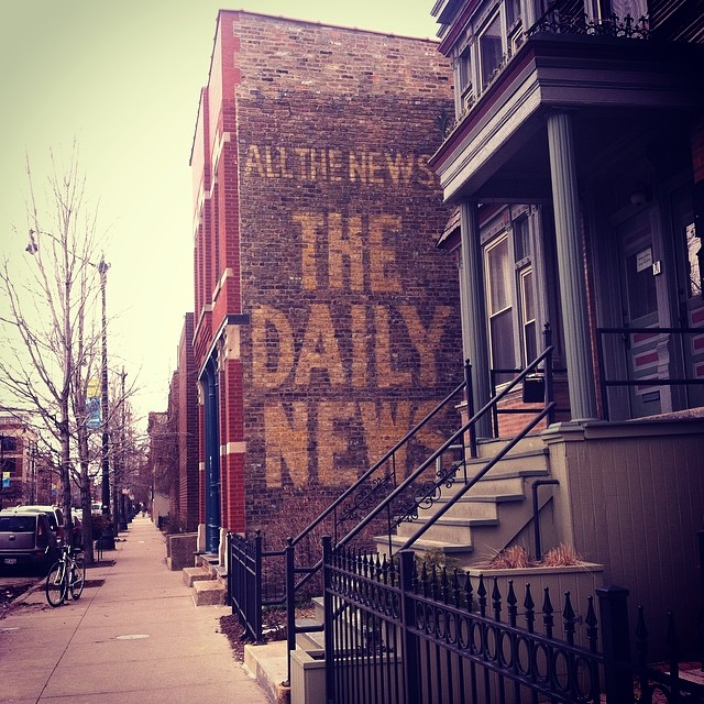 from my instagram (@laigrai). the daily news (on the side of a residential building. lincoln park. chicago, il)