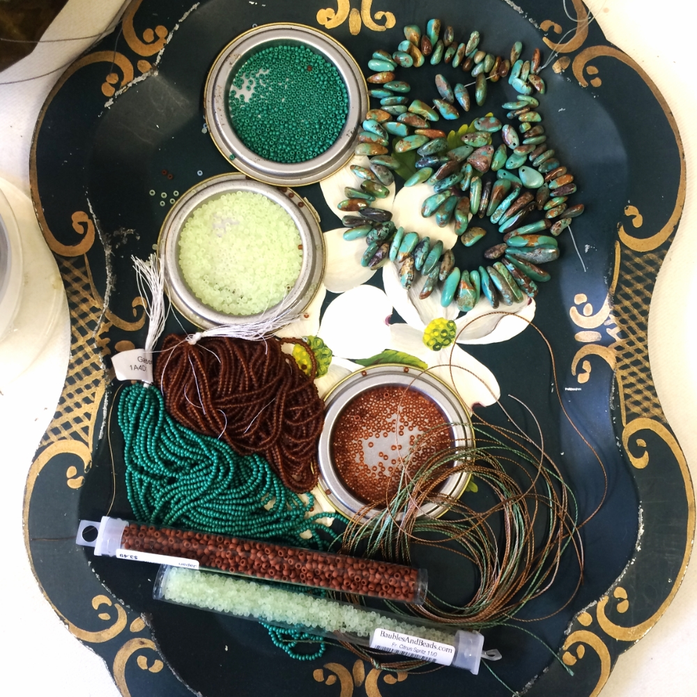 tray of turquoise and glass beads