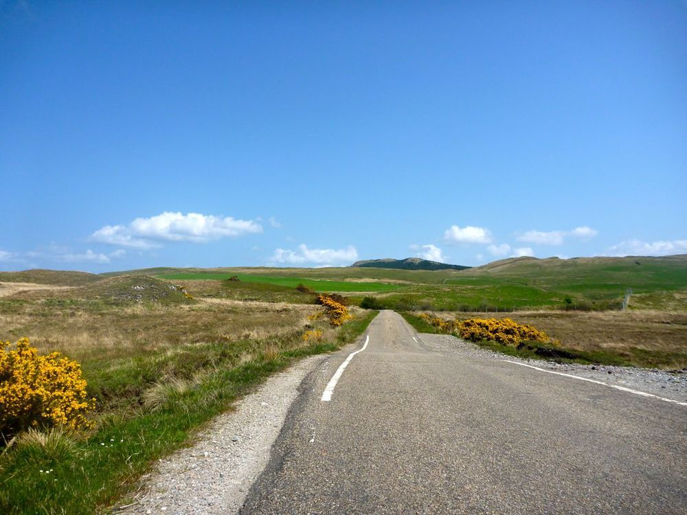 road and grassland and blue sky.jpg