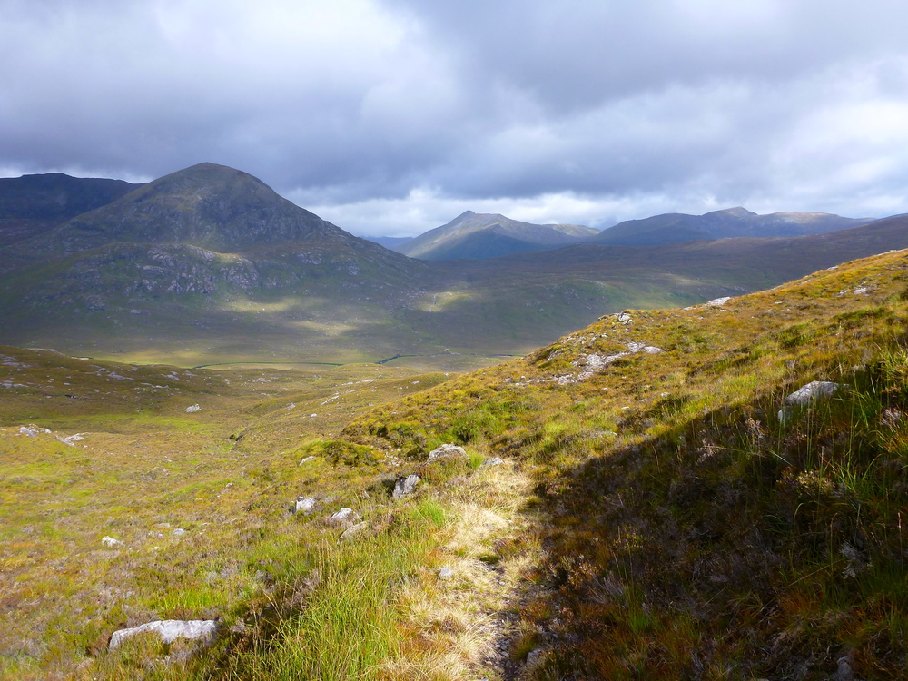 Crossing the pass, the mountains of Kintail unfolding in the distance