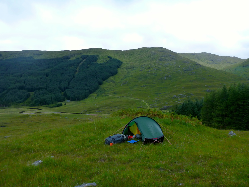 Wonderful spot to camp: a patch of dry and level ground high on the valley side. A' Chùil bothy is below the forest on the opposite side of the glen. All of this forest will be clear-felled in the next five years.