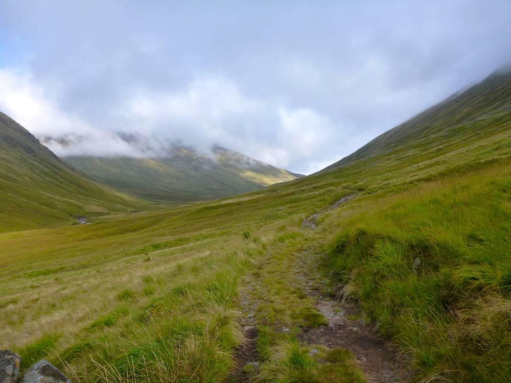 Landrover track climbing the glen.