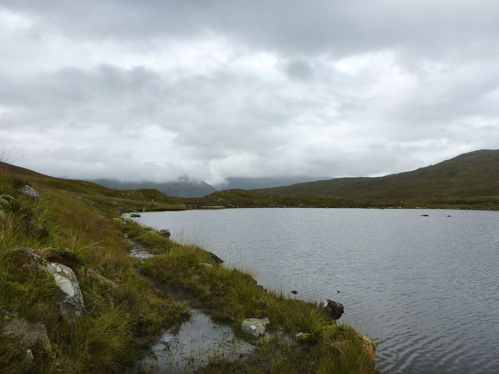 The ancient stalkers' path splashes past Loch Lòn Mhurchaidh. The tiny beach is at the far end.