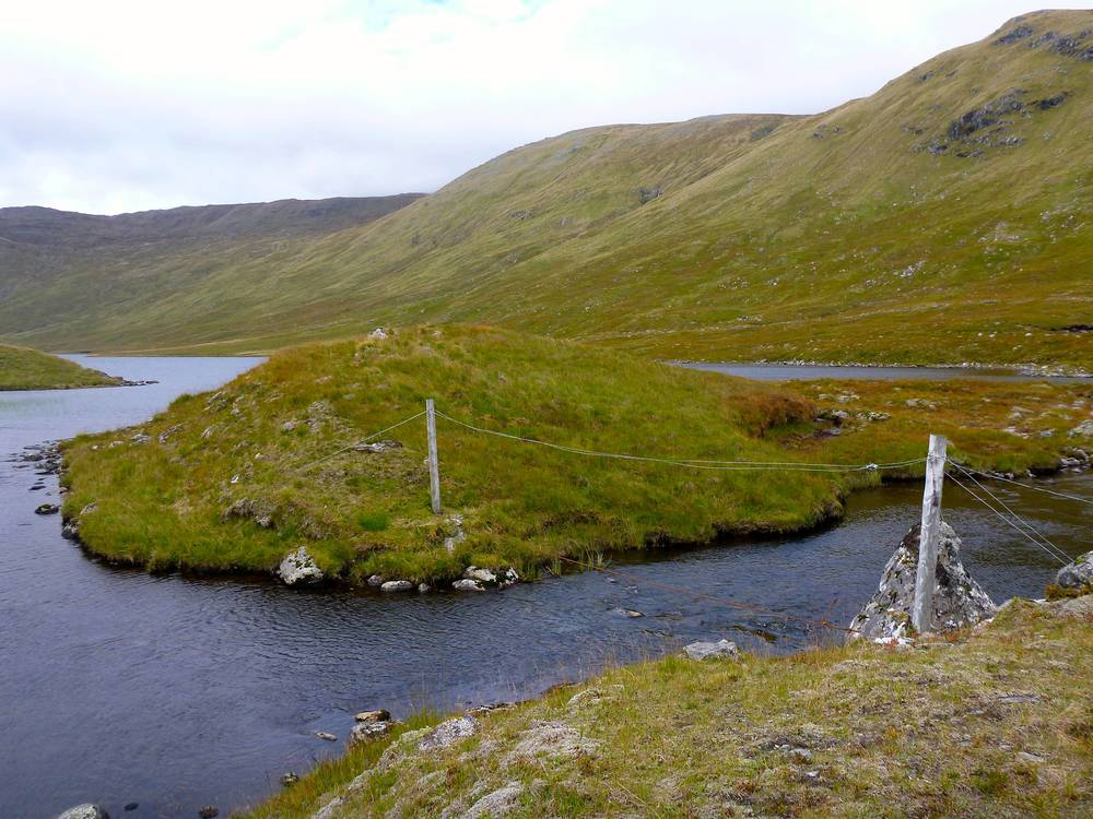 The old stalkers' path leads to this wire bridge across the Allt Loch Calavie where it rises from the loch.