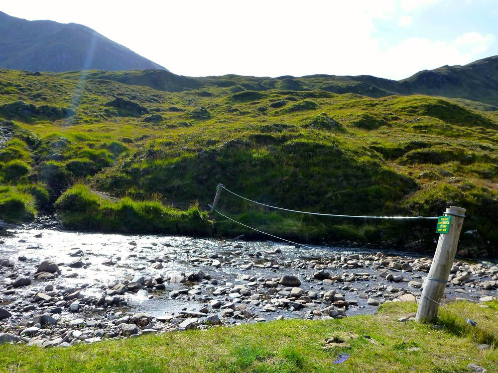 The long wire bridge across the Allt a' Chonais flowing down Glenuig at Pollan Buidhe, where the path is shown crossing the river on the OS map. Easier than it looks!