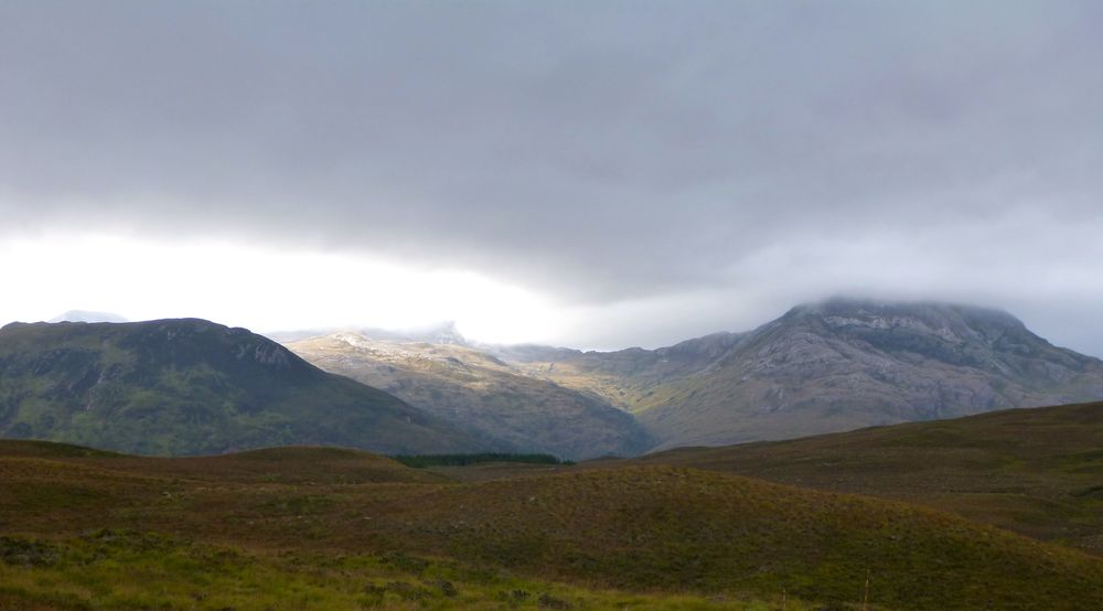 Sunlight dappling the sides of Beinn Liath Mhòr.