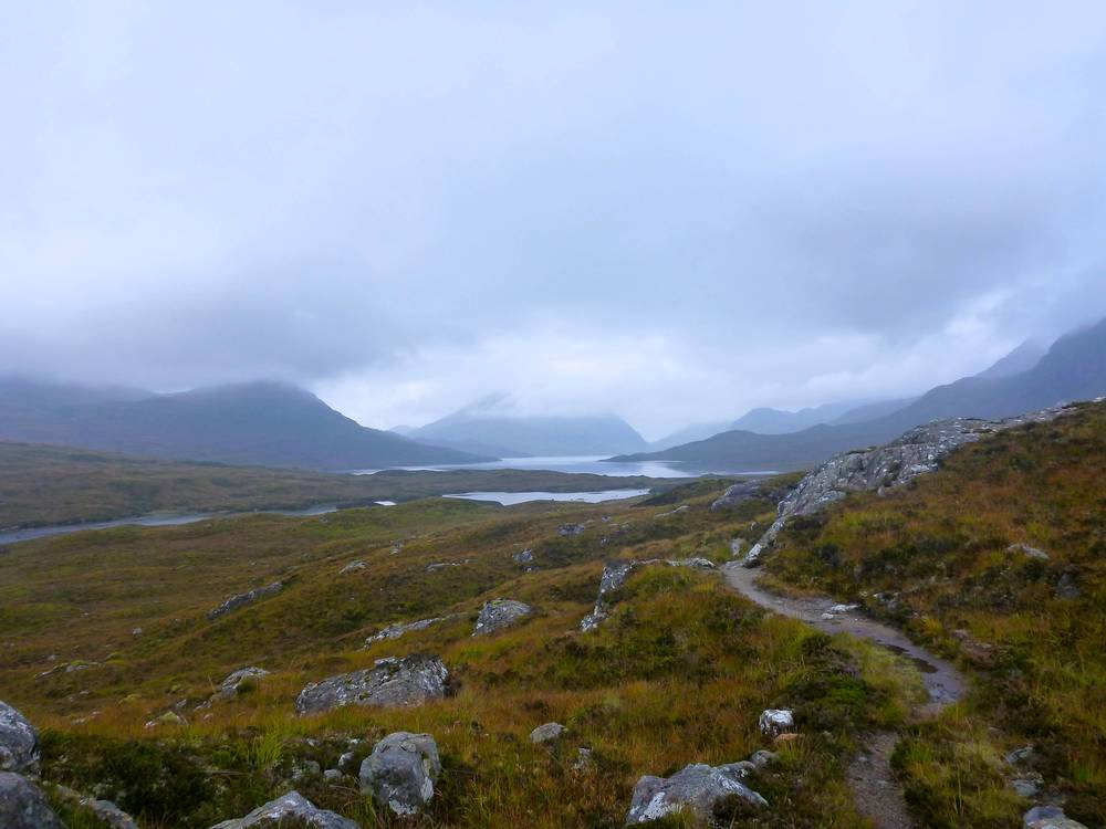 First view of Lochan Fada from the old stalkers' path; Sgùrr Dubh in the centre and Slioch to the left, while the bulk of Beinn Tarsuinn rises to the right.