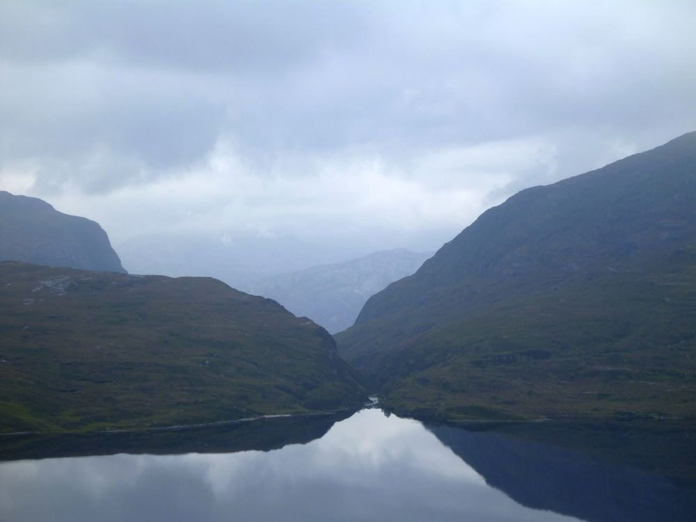 Looking across Lochan Fada to the head of Gleann Bianasdail; not originally an outflow, it was cut to form one to provide power to an ironworks on the shores of Loch Maree in the 17th century.