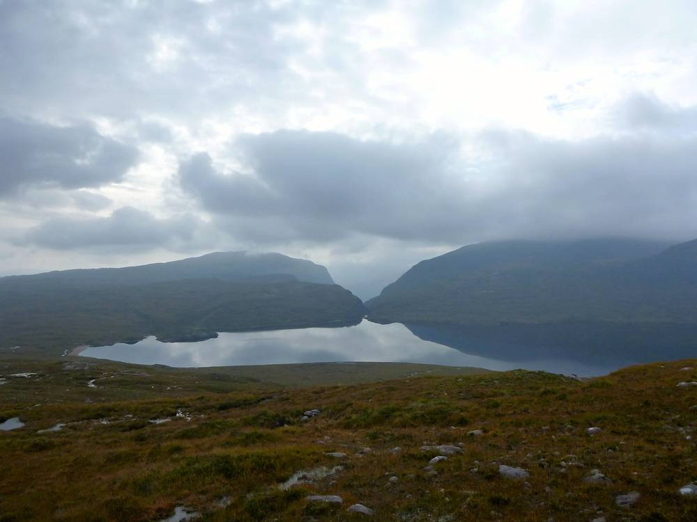 View across Lochan Fada. Slioch is swathed in cloud on the right, and Beinn Eighe is faintly visible through Gleann Bianasdail.