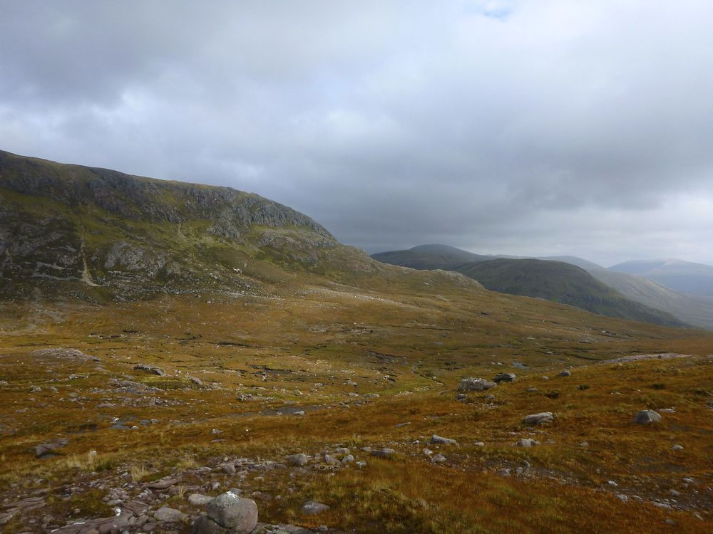The lower end of Coire Mhic Fhearchair; the Bealach na Croise is behind the crags right of centre, and leads down to the left. My route was out to the left and then across to below those crags, remaining above the peat hags and below the steep ground.