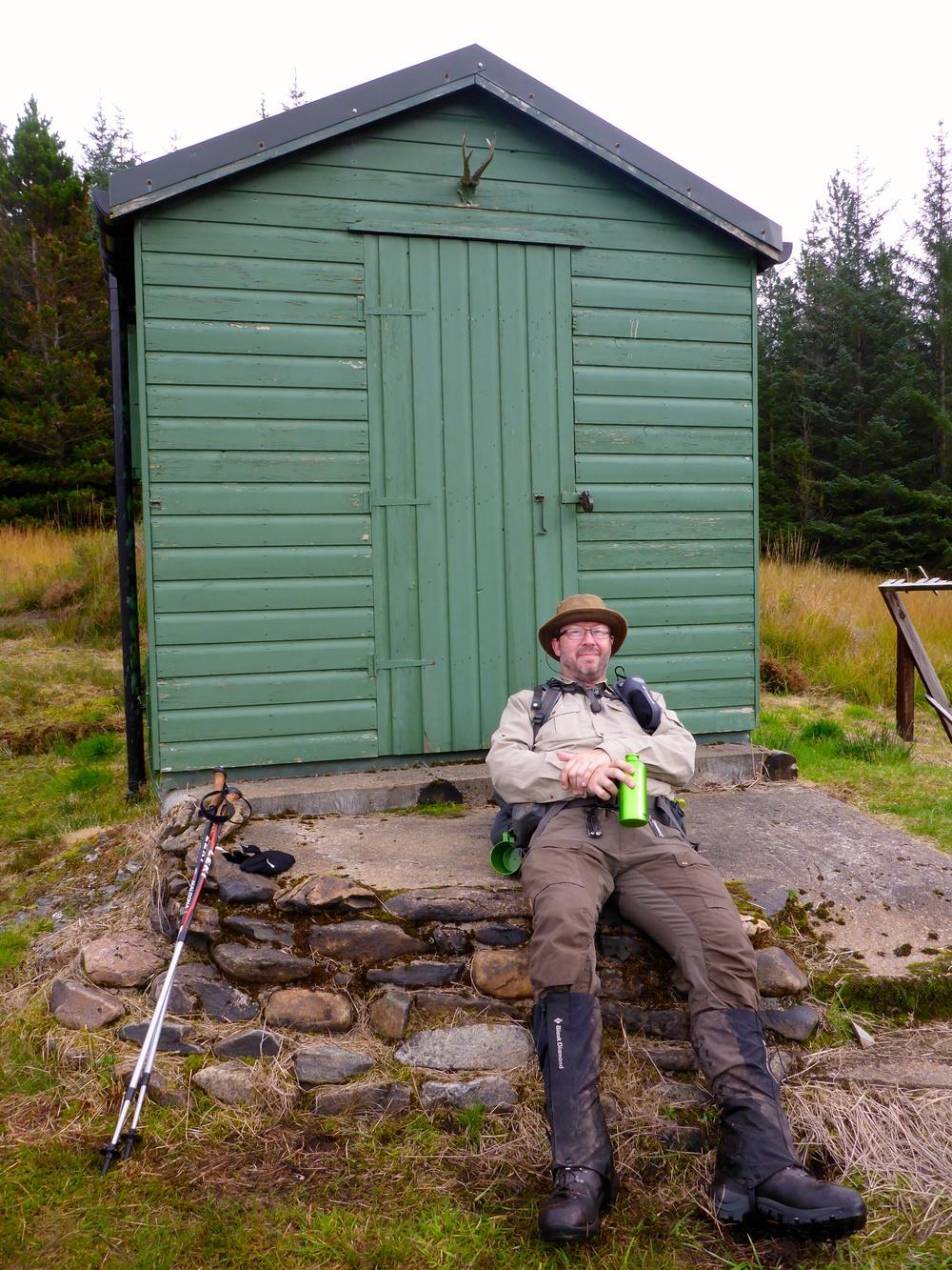 Relaxing beside a fishing hut in Glen Oykel. Those long legs make short work of the distance!