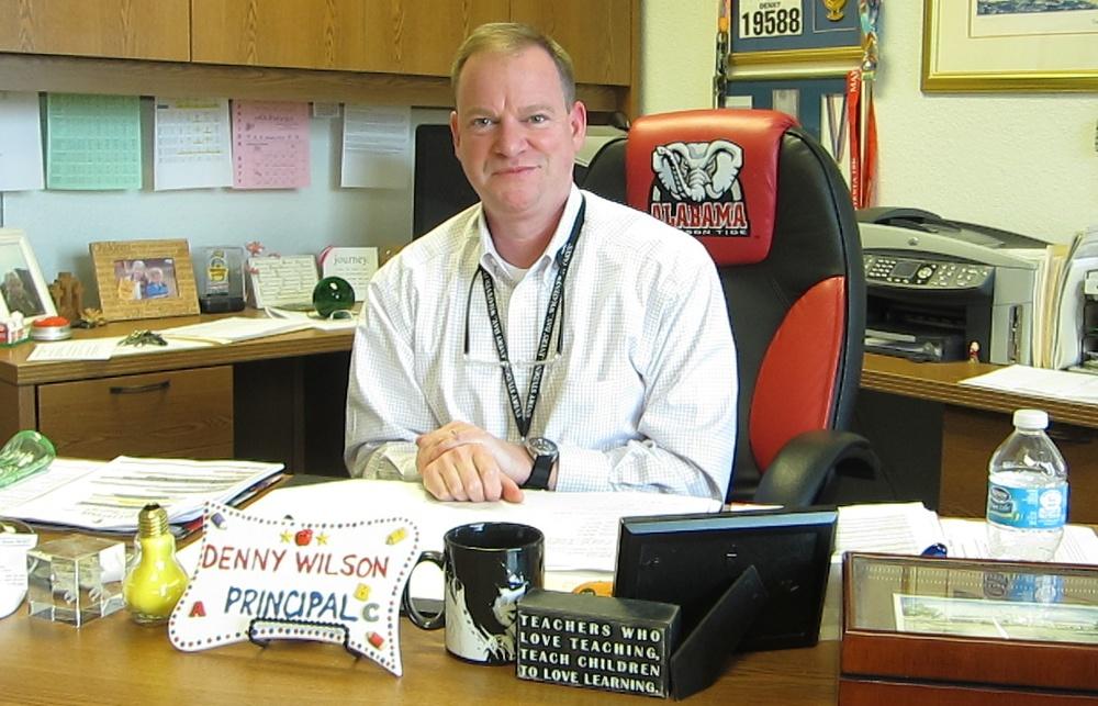 Denny Wilson in his office at Oakcrest Elementary School last school year.