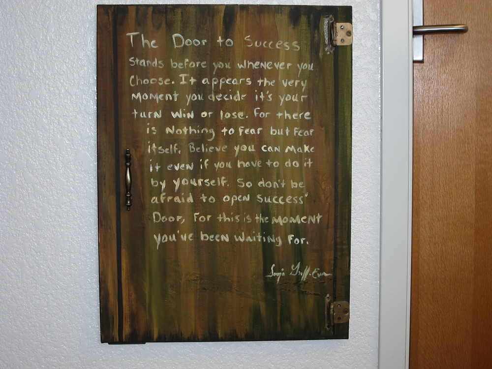 """The Door to Success"" was on the wall in Denny Wilson's Oakcrest Elementary School office."