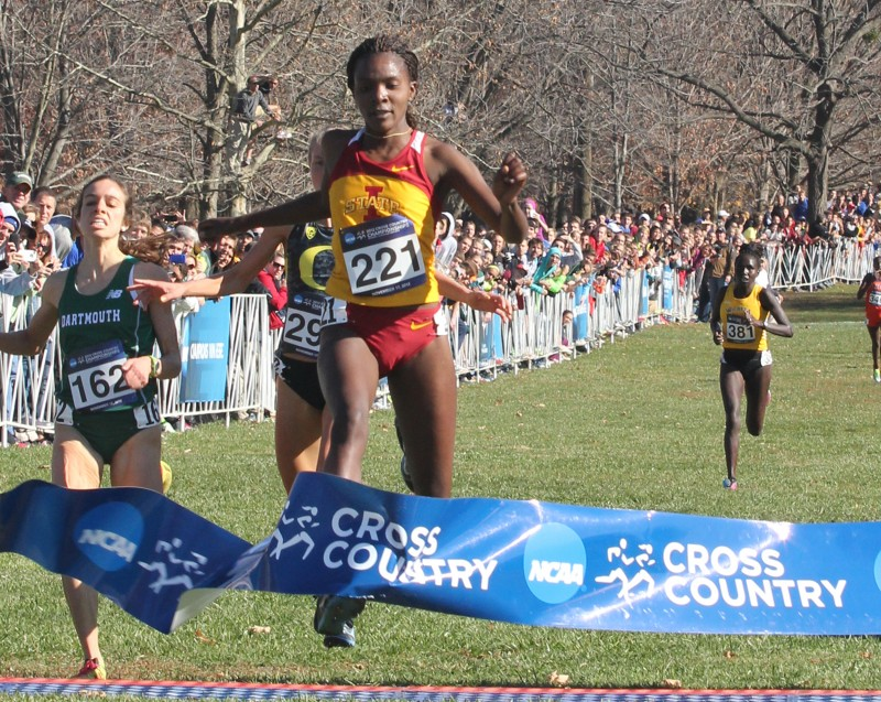 ISU women's cross-country runner Betsy Saina crosses the finish line first at the 2012 NCAA Cross-Country National Championship at E.P. Tom Sawyer Park in Louisville, Kentucky.  Photo by: William Deaton/Iowa State Daily.