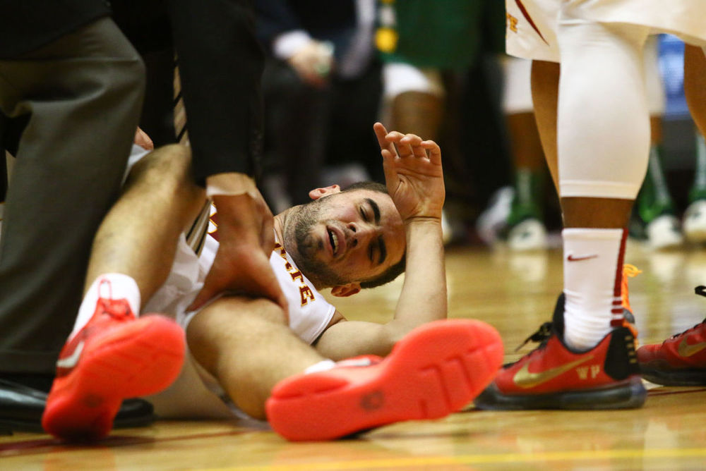 "Iowa State senior forward Georges Niang goes down with what was thought to be a knee injury during the game against North Dakota State University. In a later press conference, Niang stated that it was actually just a charlie horse. ""I probably overreacted a bit.""  Photo by: Emily Blobaum/IowaStateDaily"
