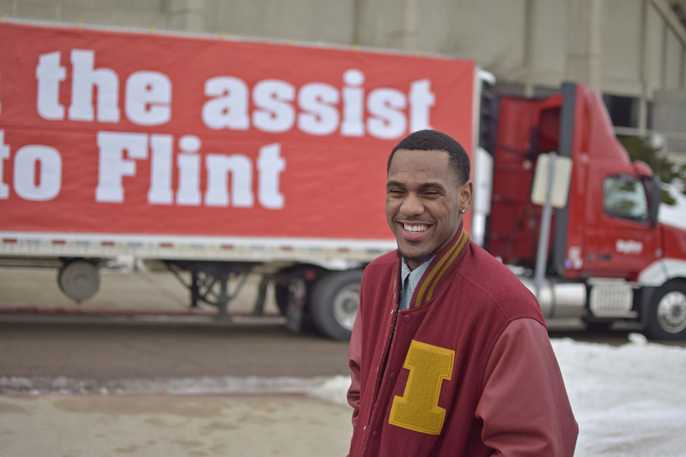 Iowa State point guard Monté Morris stands outside of Hilton Coliseum on Thursday with 11 trucks filled with drinking water. Hy-Vee helped Morris donate the water to Flint, Michigan, his hometown amid the city's water crisis.