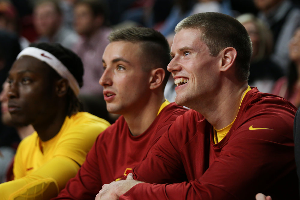 Stuart Nezlek (right) looks on during a game this season. While he rarely sees the floor, the walk-on has become a fan-favorite in Ames. Photo by Emily Blobaum/IowaStateDaily