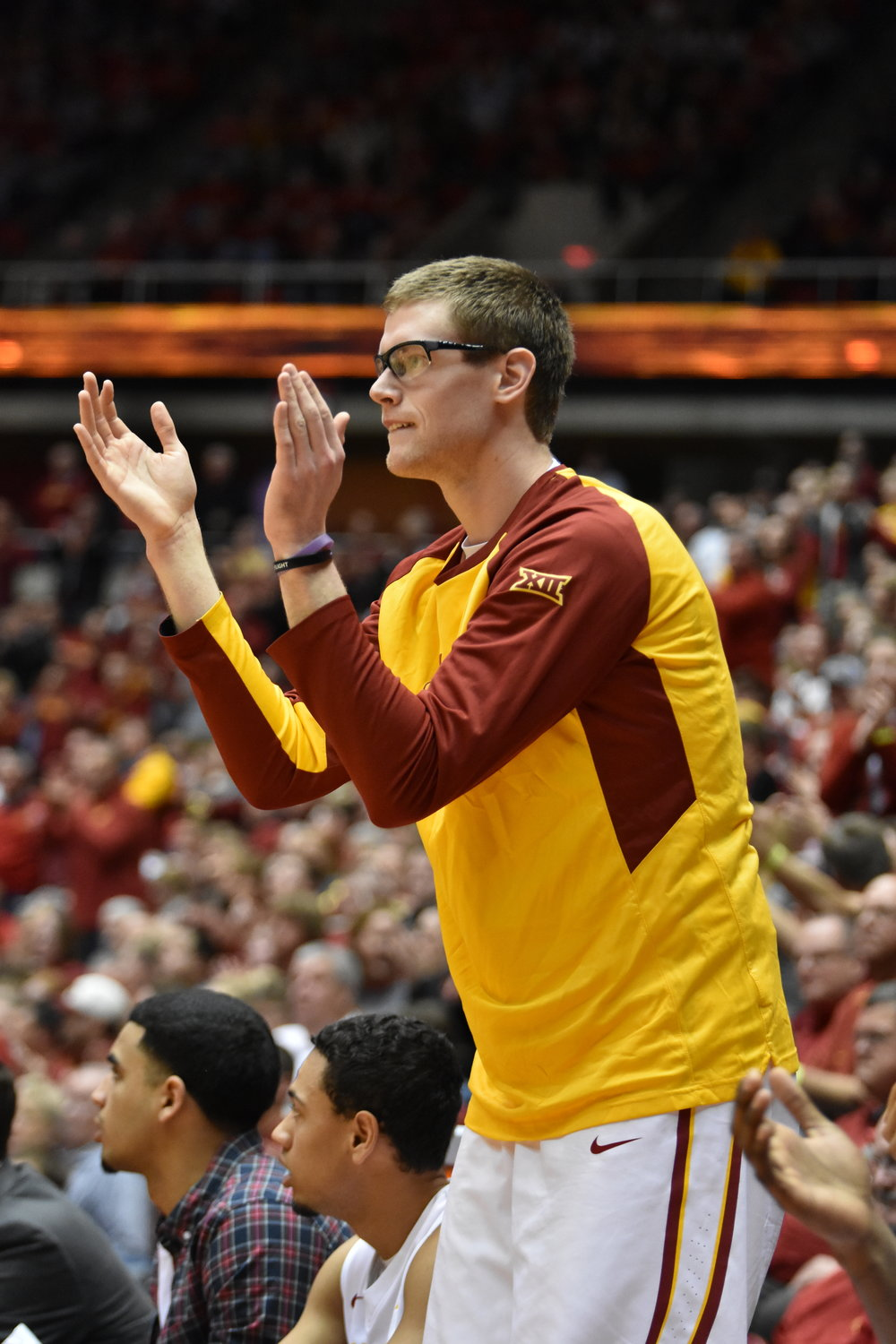 Stuart Nezlek cheers from the bench during the 2015-2016 season. Photo by Lani Tons/Iowa State Daily