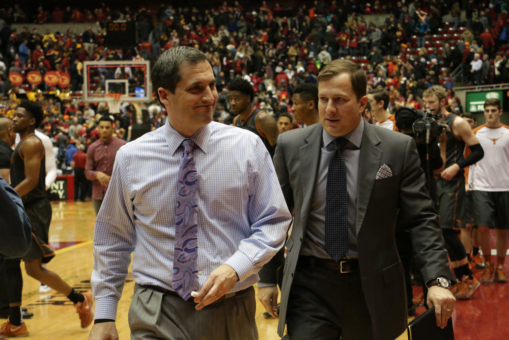 Iowa State coach Steve Prohm (left) walks to the tunnel with former-assistant coach T.J. Otzelberger after the Cyclones' game against Texas last season. Photo by Emily Blobaum/Iowa State Daily
