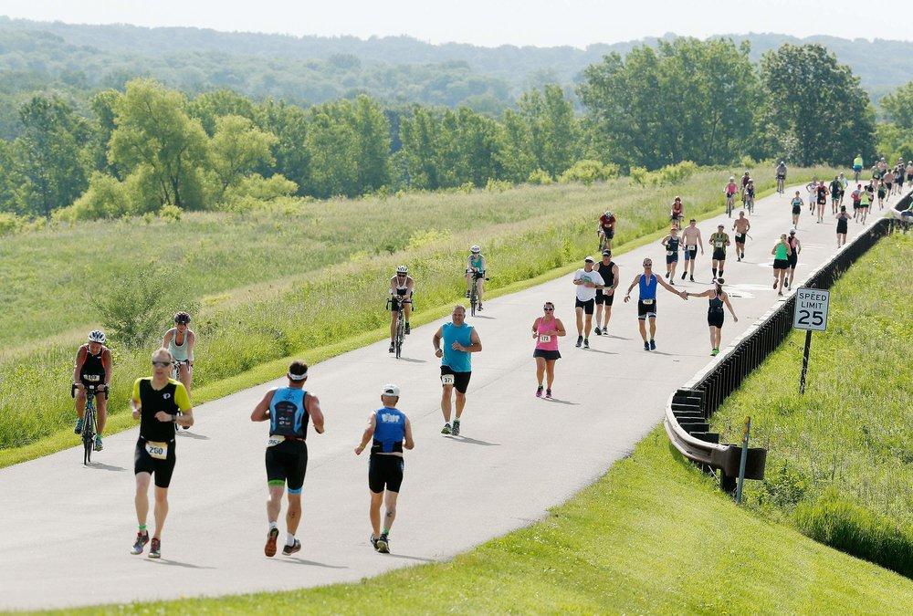 The Pigman Triathlon took place in Palo, Iowa, on June 5, 2017, and featured a variety of competitors across all skill levels on the sprint course. (Cliff Jette/The Gazette)
