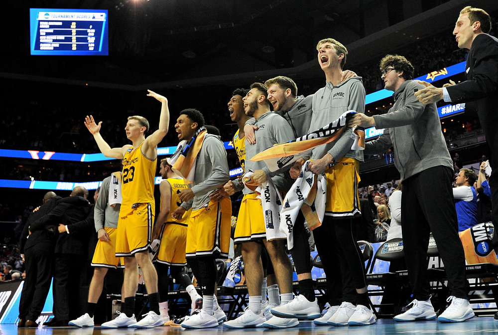 The UMBC Retrievers bench reacts near the end their game against the Virginia Cavaliers during the first round of the 2018 NCAA Men's Basketball Tournament at Spectrum Center on March 16, 2018 in Charlotte, North Carolina. (Jared C. Tilton/Getty Images)